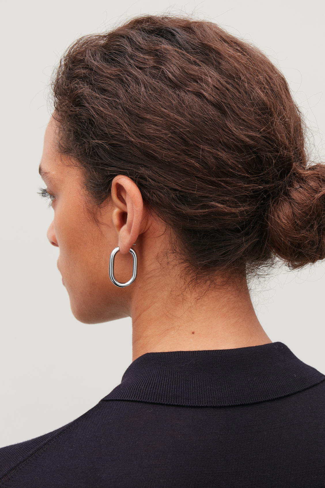 Detailed image of Cos oval hoop earrings in silver