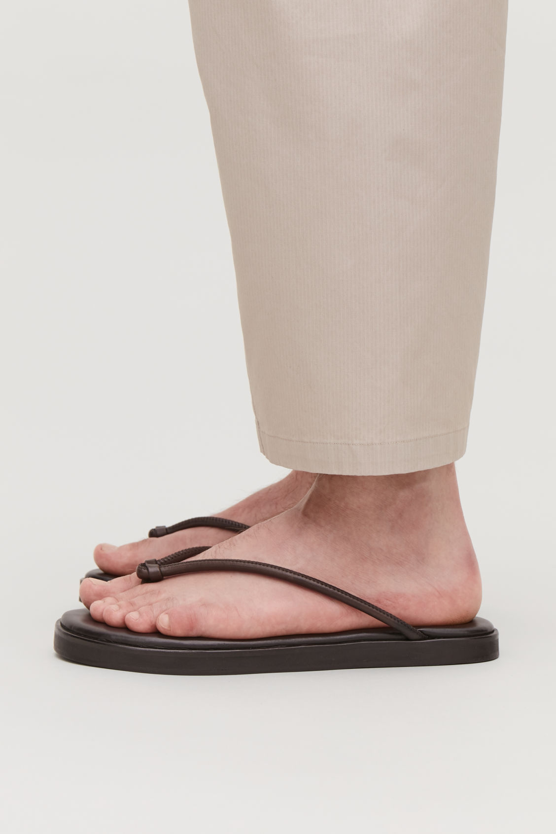 Detailed image of Cos leather flip flops  in brown