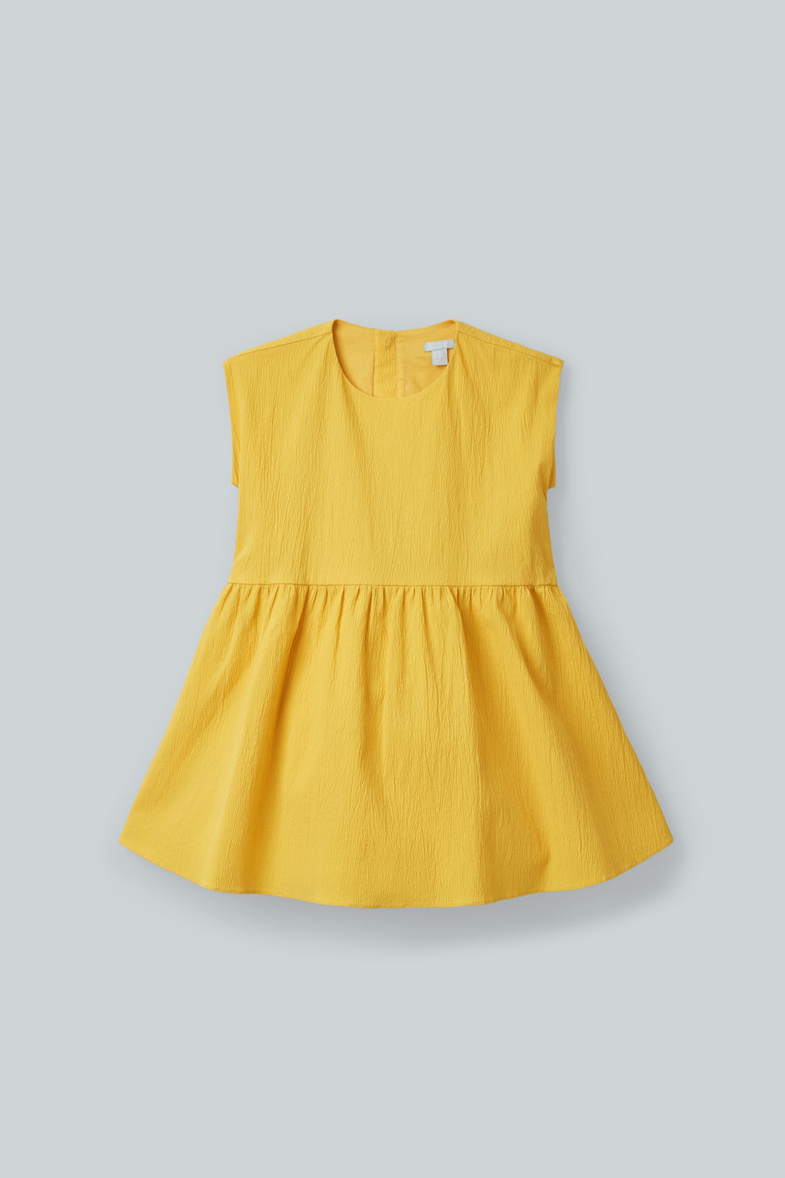 Detailed image of Cos seersucker circle-cut dress in yellow