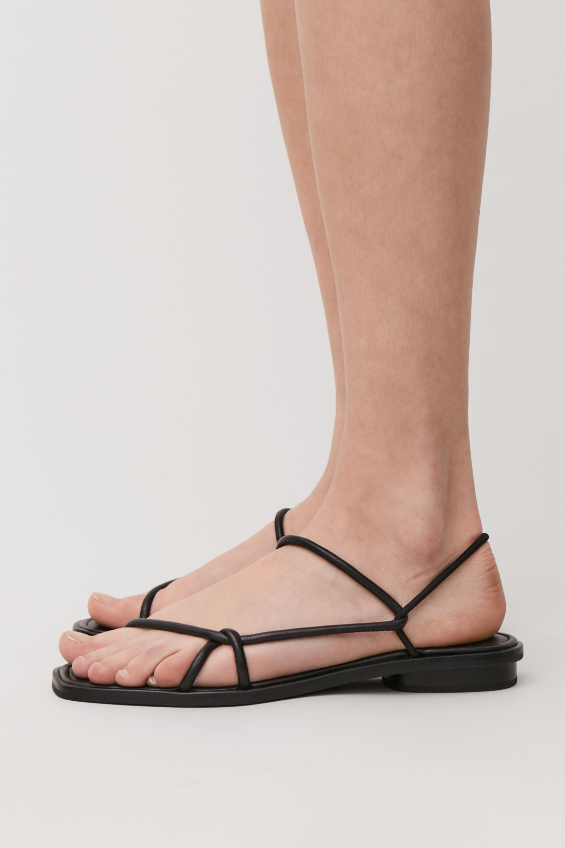 Detailed image of Cos strappy flat sandals in black