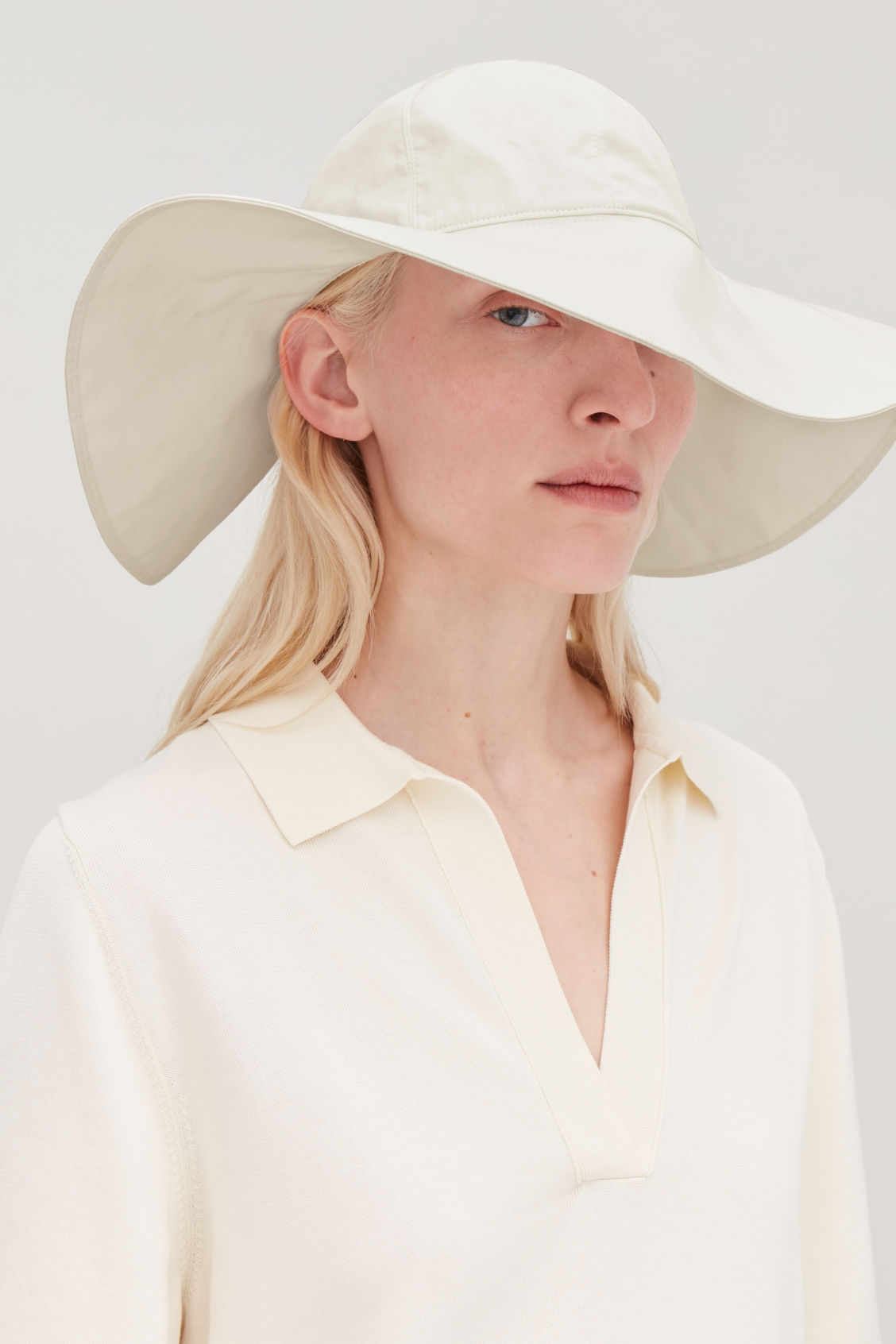 Detailed image of Cos wide-brim hat with open back in cream