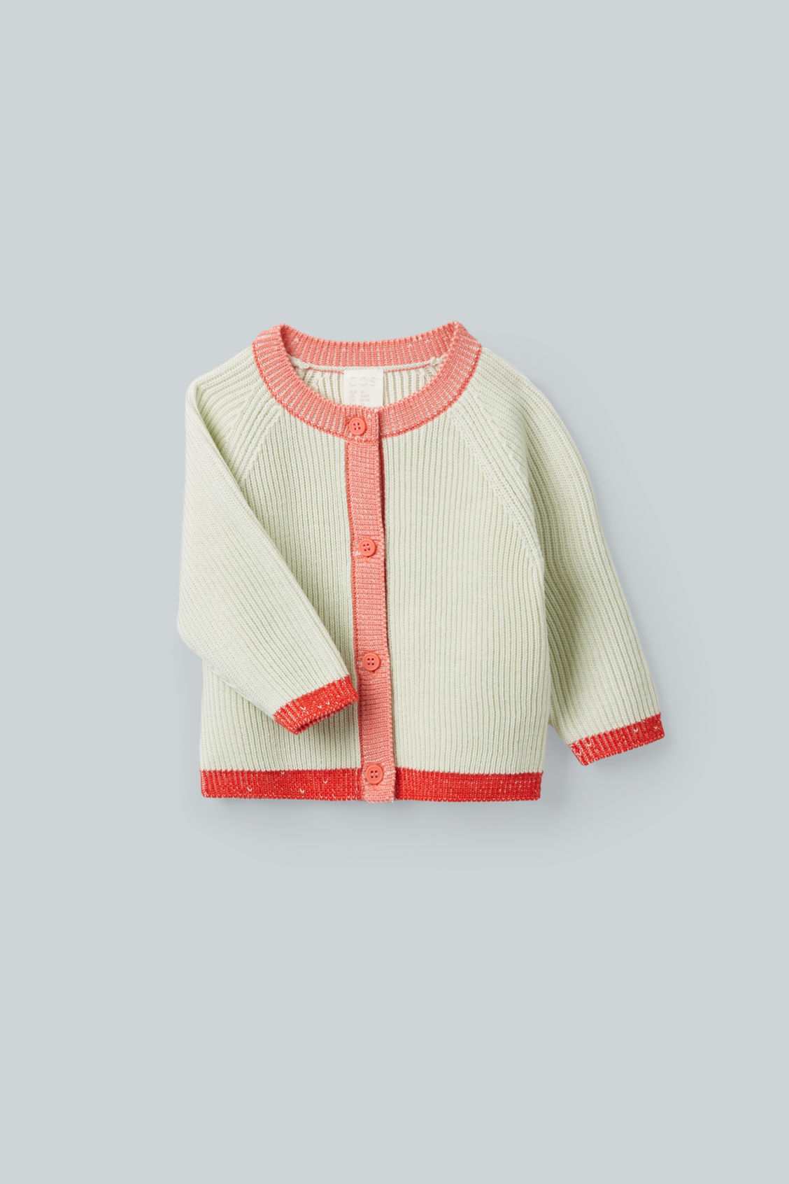 Detailed image of Cos merino colour-block cardigan in green