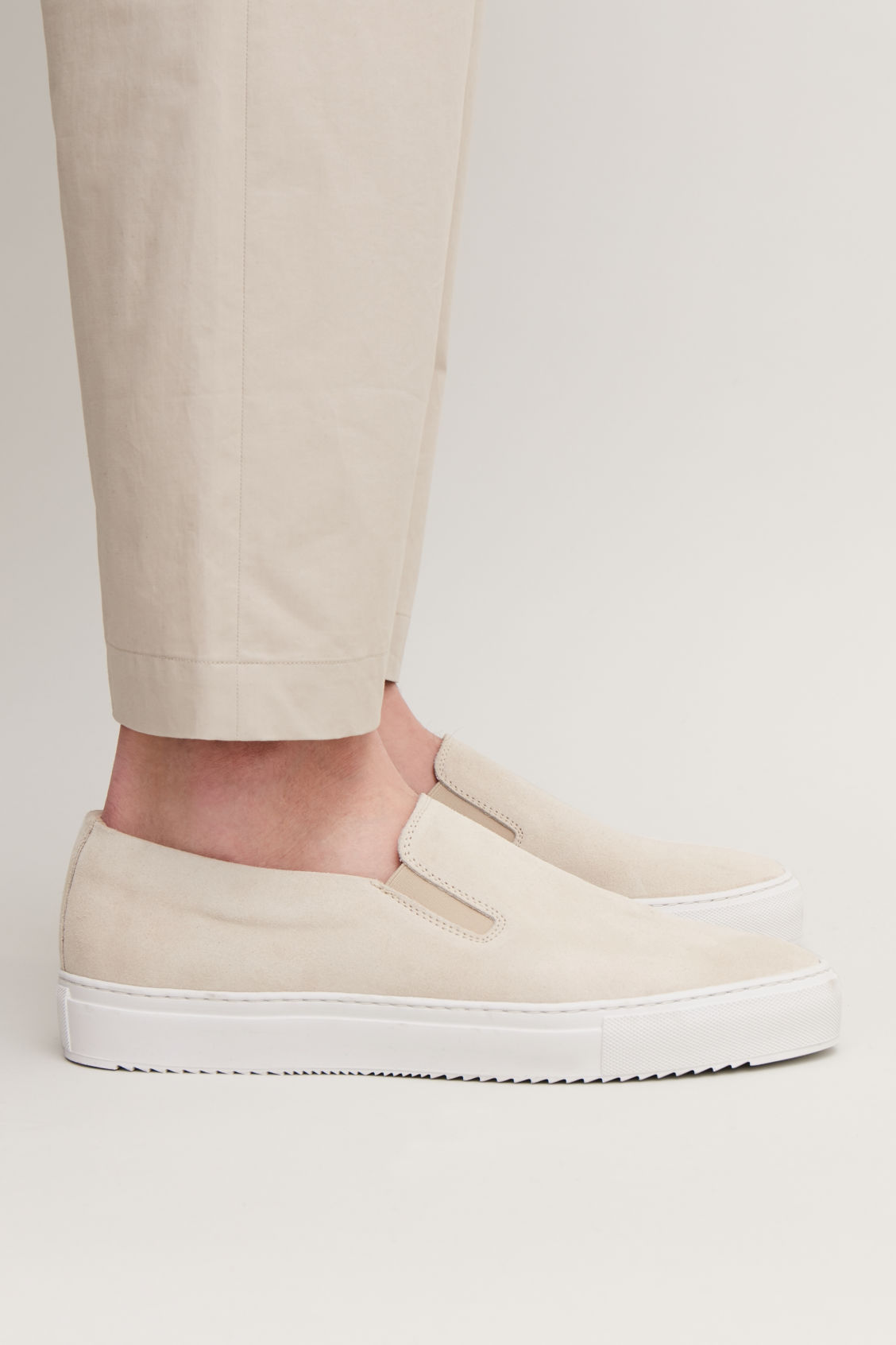 Detailed image of Cos suede slip-on sneakers  in cream